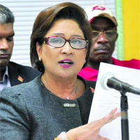 Persad-Bissessar announcing the SoE...pretty dangerous!