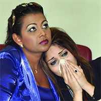 Liana ramsahai being consoled by Priya Ramnarine. Photo courtesy Express newspaper website.