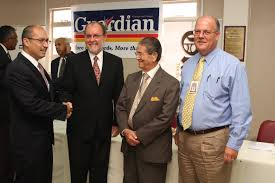 Gabriel Faria (left) with other members of the Guardian Media Ltd Board.